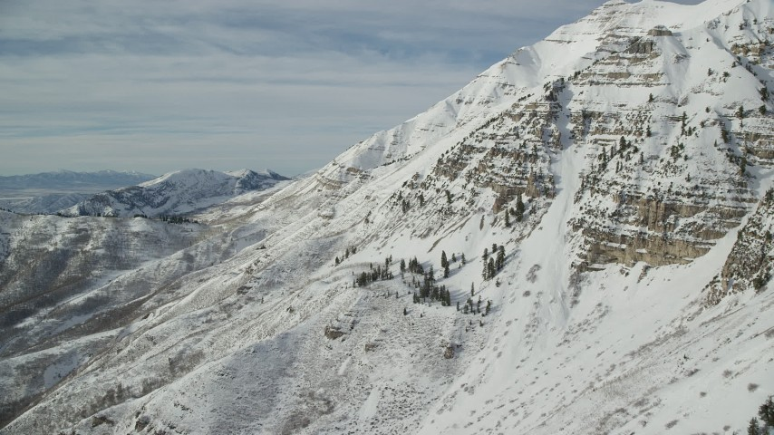 6K stock footage aerial video of snow covered slopes of Mount Timpanogos in wintertime, Utah Aerial Stock Footage | AX126_257