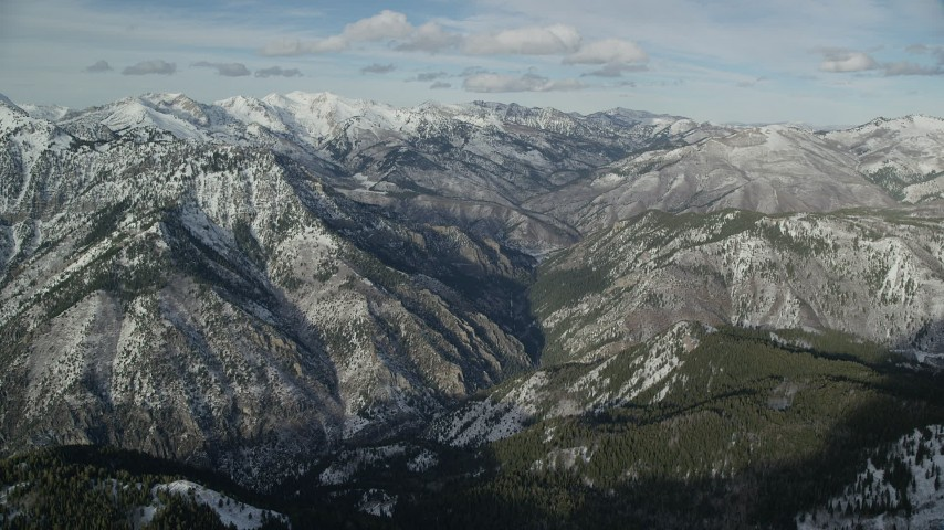 Approach Wasatch Range Mountains with Light Snow in Winter Aerial Stock Footage   AX126_272