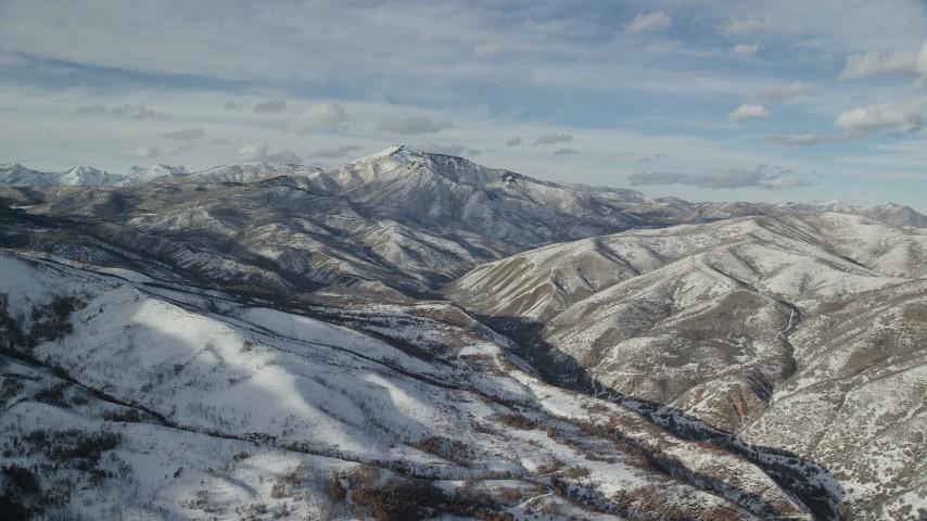 6K stock footage aerial video of Mill Canyon Peak with winter snow seen from Deer Creek Reservoir, Utah Aerial Stock Footage | AX126_304