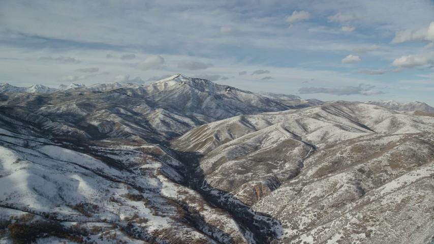 Snowy Mill Canyon Peak in Winter seen from Deer Creek Reservoir Aerial Stock Footage | AX126_305