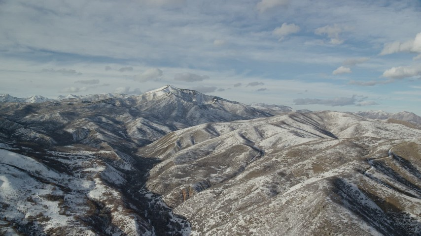 Snowy Wasatch Range Mountains with Mill Canyon Peak in the Distance Aerial Stock Footage | AX126_306