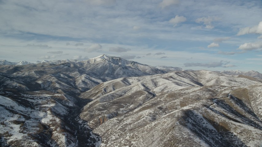 6K stock footage aerial video of snowy Wasatch Range mountains with Mill Canyon Peak in the distance, Utah Aerial Stock Footage | AX126_306
