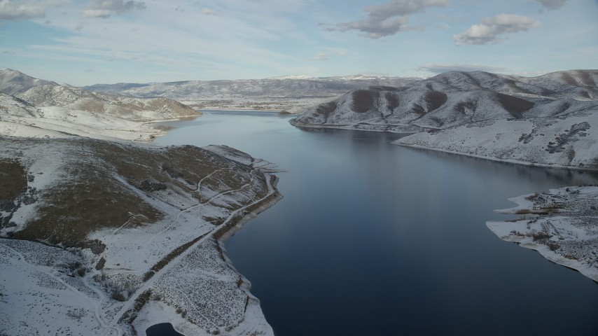 6K stock footage aerial video of flying over Deer Creek Reservoir toward Heber City in winter, Utah Aerial Stock Footage | AX126_308
