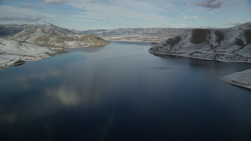 6K stock footage aerial video approach Heber City while flying over Deer Creek Reservoir in winter, Utah Aerial Stock Footage | AX126_310