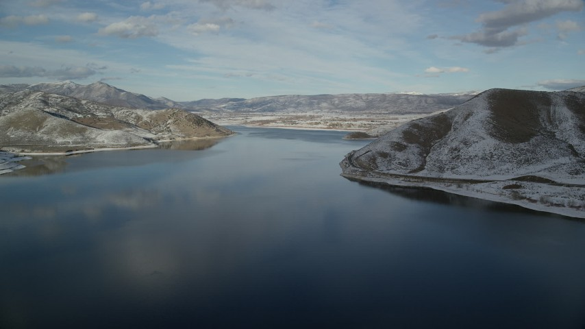 6K stock footage aerial video approach Heber City on the shore of the Deer Creek Reservoir in winter, Utah Aerial Stock Footage | AX126_311