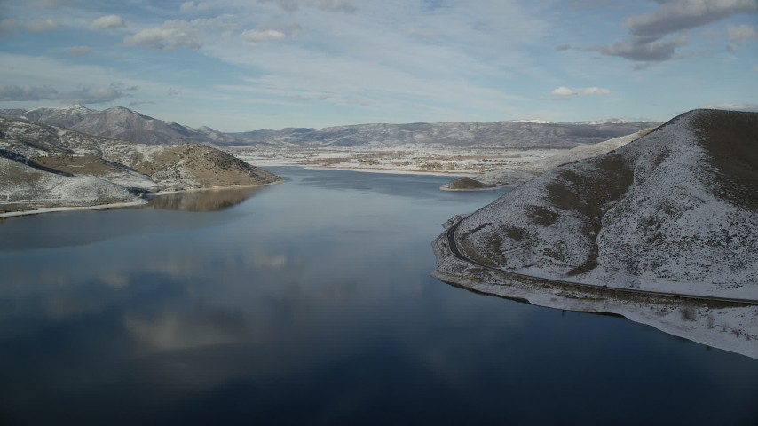 6K stock footage aerial video approach Heber City from Deer Creek Reservoir in wintertime, Utah Aerial Stock Footage | AX126_312