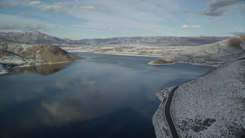 6K stock footage aerial video of passing a highway on the shore of the reservoir and approach Heber City in winter, Utah Aerial Stock Footage | AX126_313