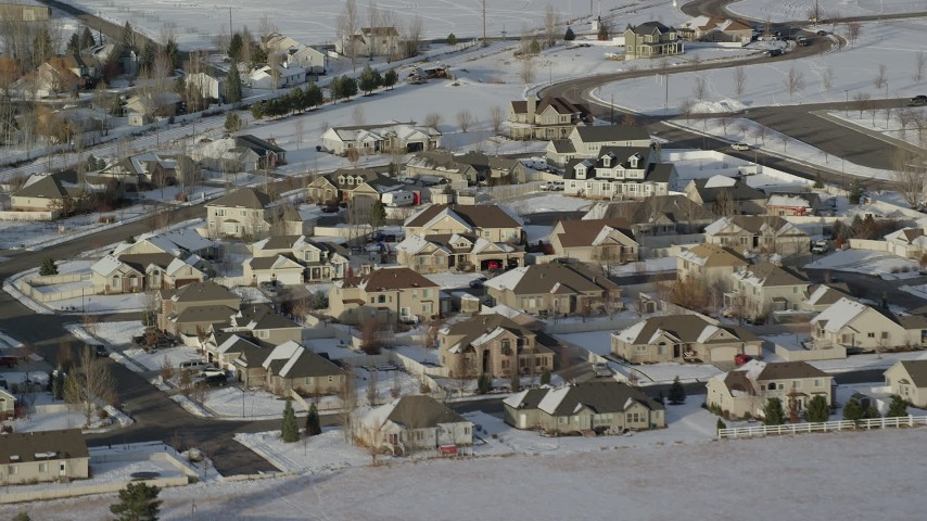6K stock footage aerial video of tract homes with winter snow in a small town, Heber City, Utah Aerial Stock Footage | AX127_003
