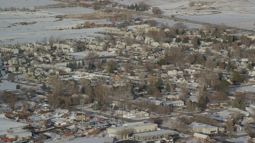 6K stock footage aerial video orbit small town residential neighborhoods with winter snow, Heber City, Utah Aerial Stock Footage | AX127_005