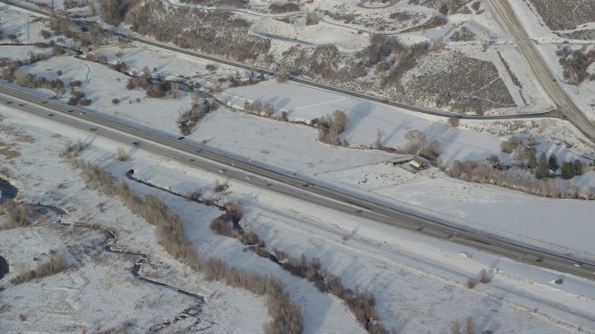 6K stock footage aerial video of light traffic on highway through snowy countryside in winter, Heber City, Utah Aerial Stock Footage | AX127_009