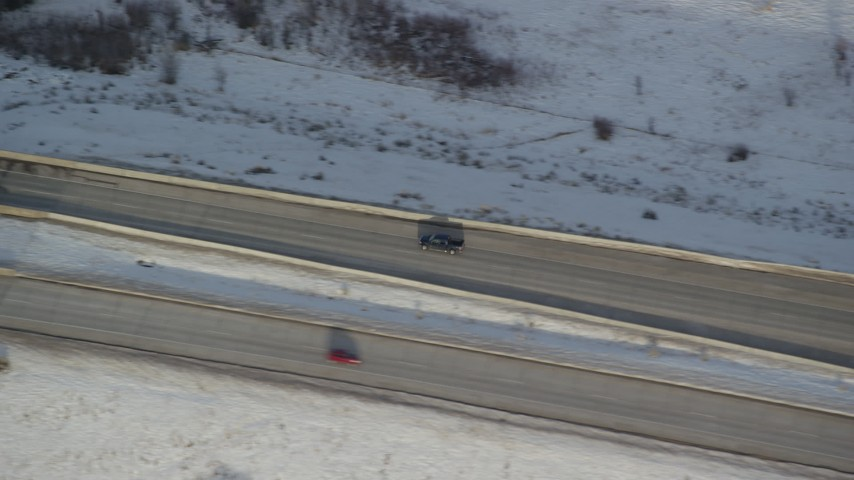 6K stock footage aerial video of tracking a black truck on a county highway and crossing a small bridge in winter, Heber City, Utah Aerial Stock Footage | AX127_012