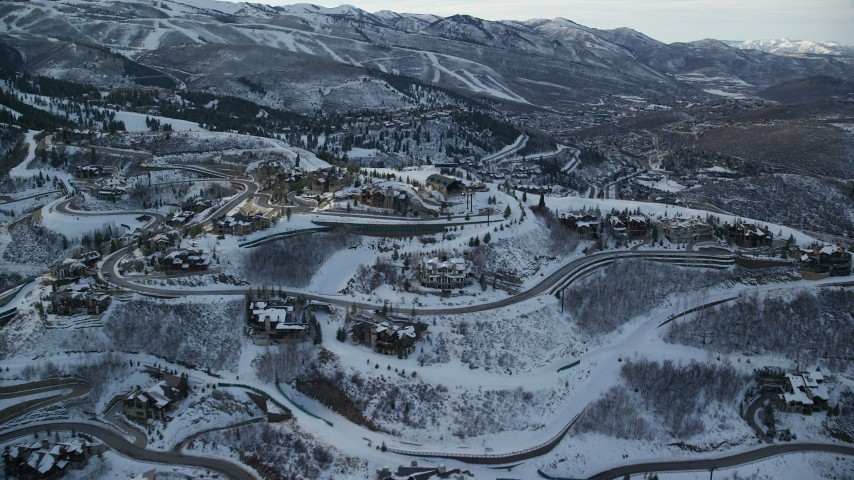Orbit Deer Valley Mansions On A Mountaintop With Light Snow In Winter At Sunset Aerial Stock Footage AX127 019