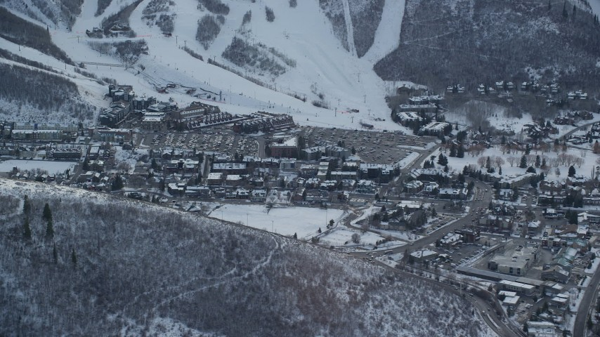 6K stock footage aerial video of center of town in Park City with light winter snow at sunset, Utah Aerial Stock Footage AX127_023   Axiom Images