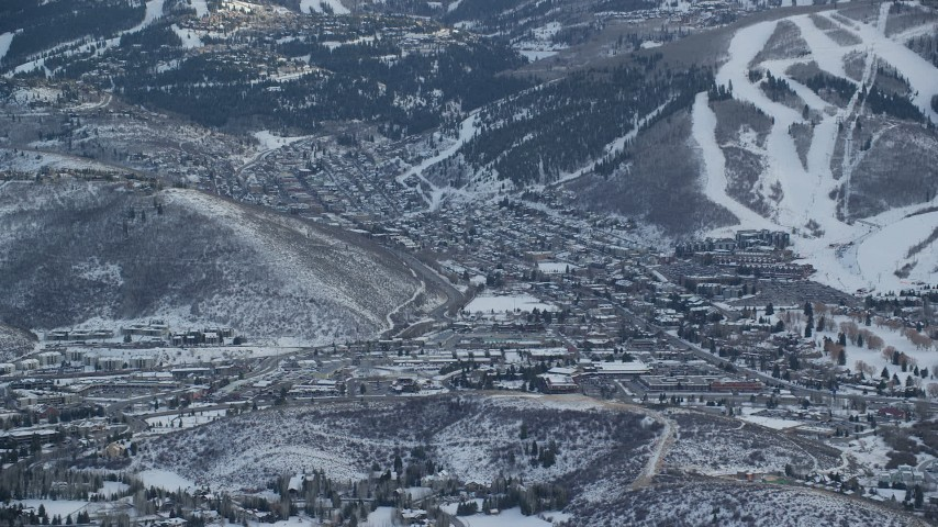 6K stock footage aerial video orbit Park City in winter, seen from north of the town, Utah Aerial Stock Footage | AX127_028