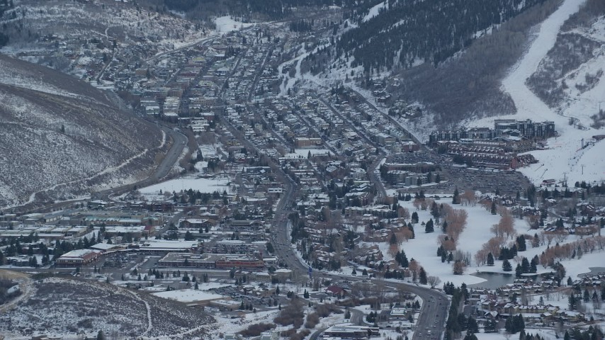 6K stock footage aerial video of circling Park City with winter snow at sunset, Utah Aerial Stock Footage | AX127_030