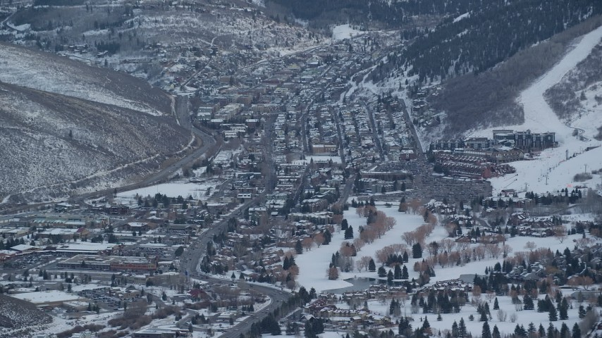 6K stock footage aerial video of an orbit of Park City, Utah, with winter snow on the ground at sunset Aerial Stock Footage | AX127_031