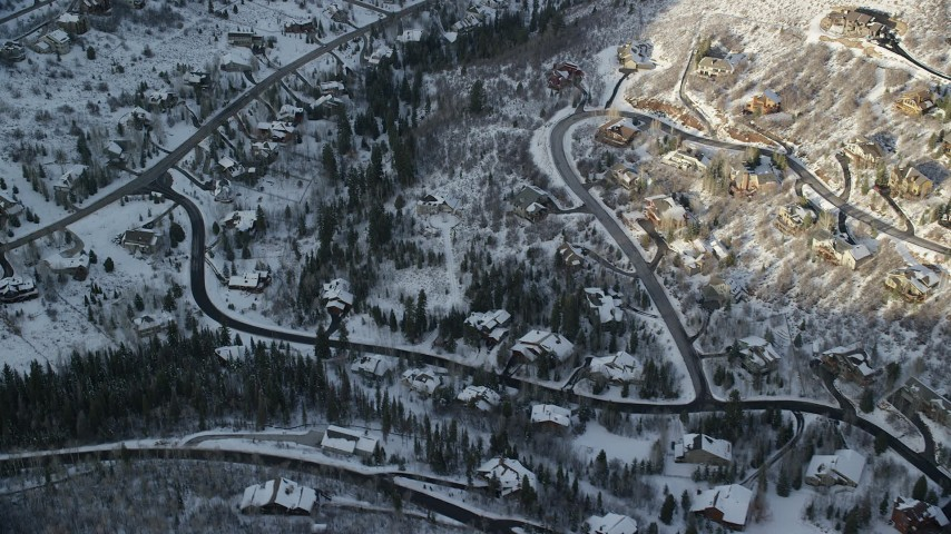 6K stock footage aerial video flyby homes on a snowy hillside at sunset in winter, Park City, Utah Aerial Stock Footage   AX127_040