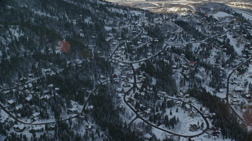 6K stock footage aerial video approach residential neighborhoods in the shadow of a snowy mountain at sunset, Park City, Utah Aerial Stock Footage   AX127_043