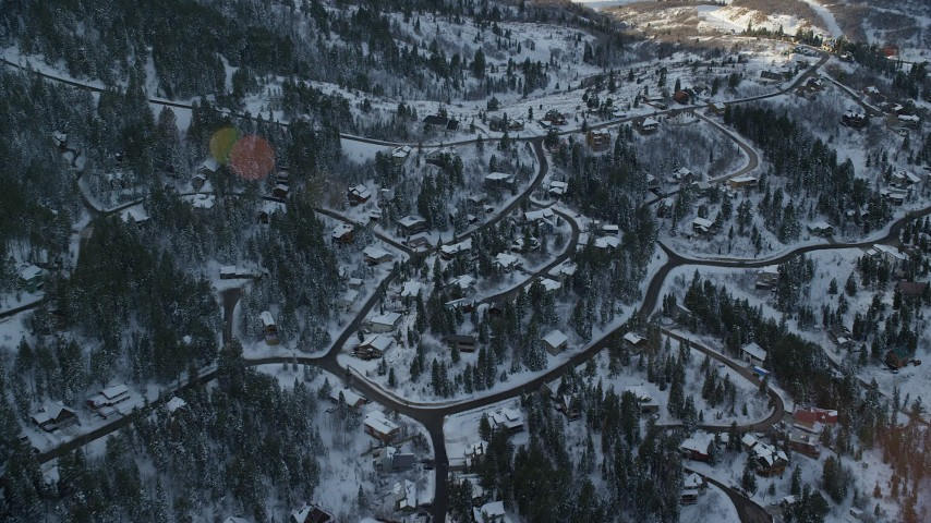 6K stock footage aerial video of a residential neighborhood at sunset with winter snow on the ground, Park City, Utah Aerial Stock Footage | AX127_044