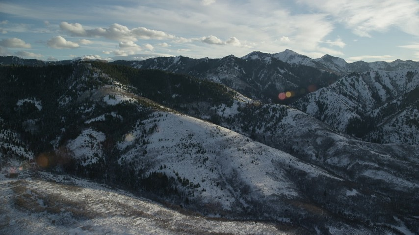 6K stock footage aerial video of Wasatch Range mountains covered in light winter snow, Utah Aerial Stock Footage | AX127_049