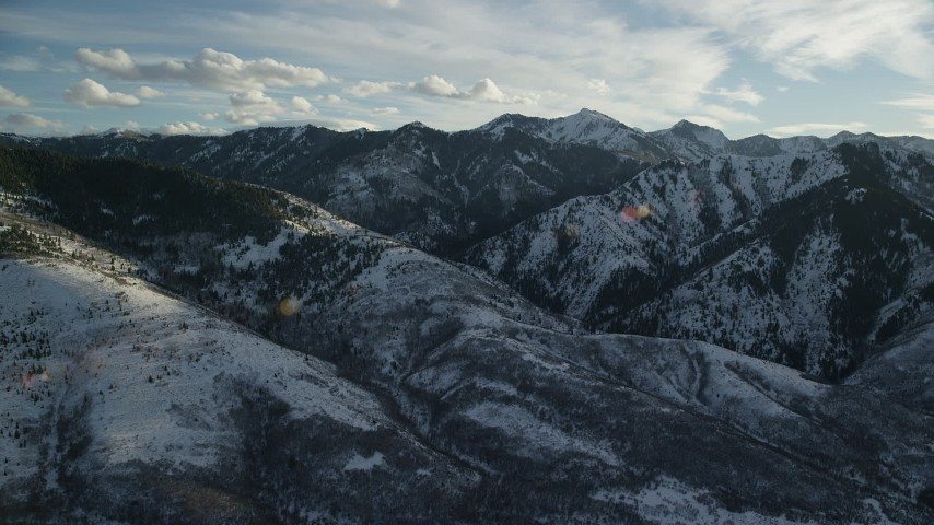 6K stock footage aerial video flyby Wasatch Range snow mountains in wintertime, Utah Aerial Stock Footage | AX127_050