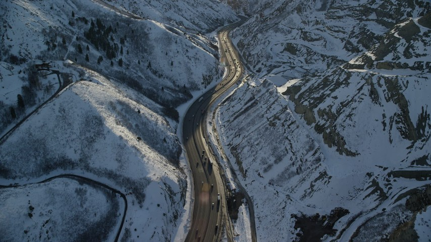 6K aerial stock footage video of I-80 through wintery Wasatch Range at sunset, Utah Aerial Stock Footage | AX127_067