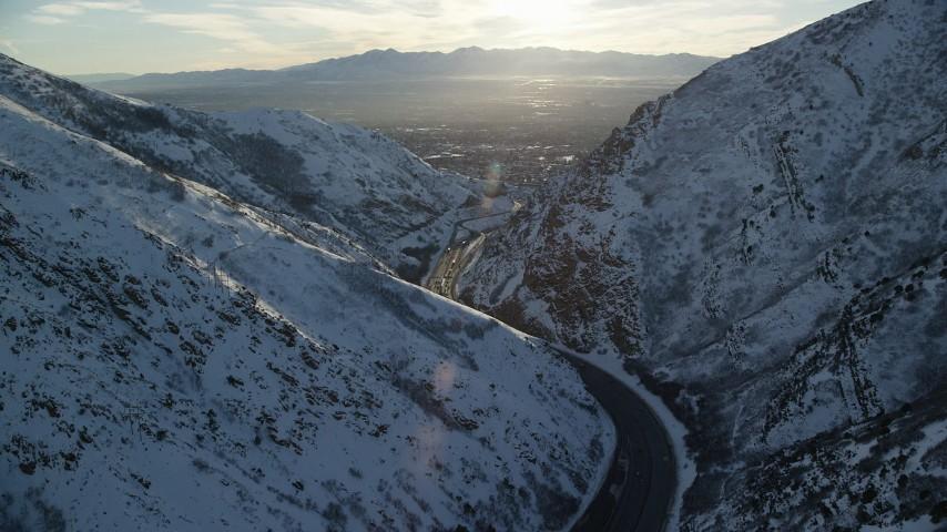 6K stock footage aerial video of I-80 through Wasatch Range toward Salt Lake City at sunset, Utah Aerial Stock Footage | AX127_070