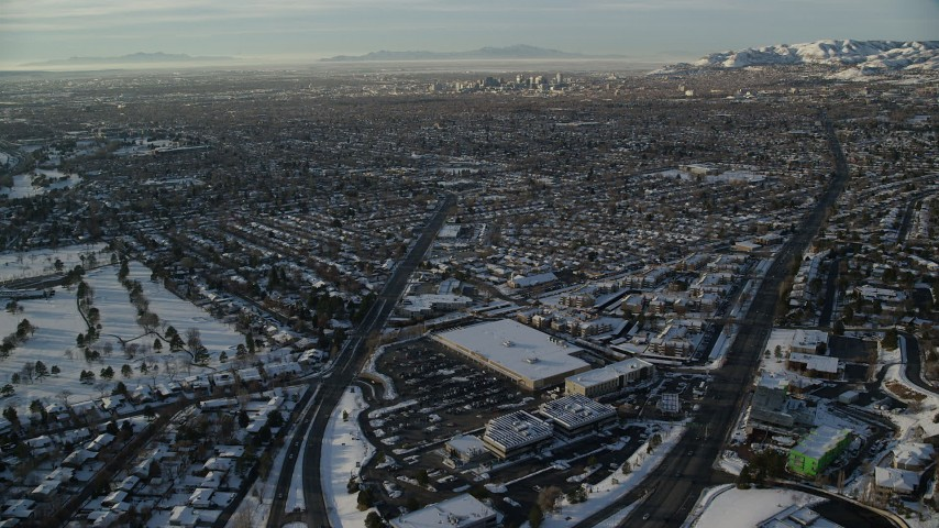 6K stock footage aerial video approach Downtown Salt Lake City from suburbs at sunset in wintertime, Utah Aerial Stock Footage | AX127_076
