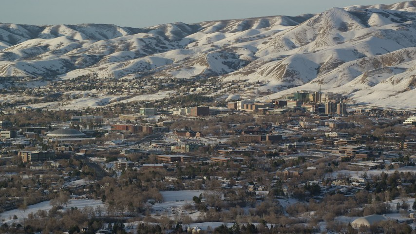 Approaching the University of Utah Campus at the Base of Snowy Mountains at Sunset Aerial Stock Footage | AX127_077