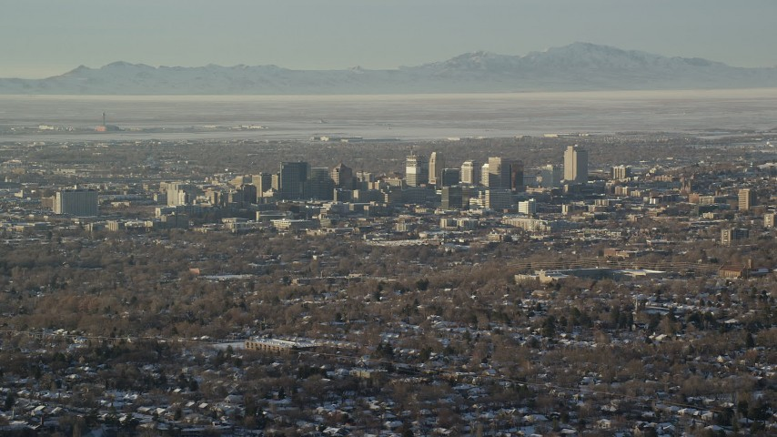 6K stock footage aerial video of a wide orbit of Downtown Salt Lake City in winter at sunset, Utah Aerial Stock Footage | AX127_078