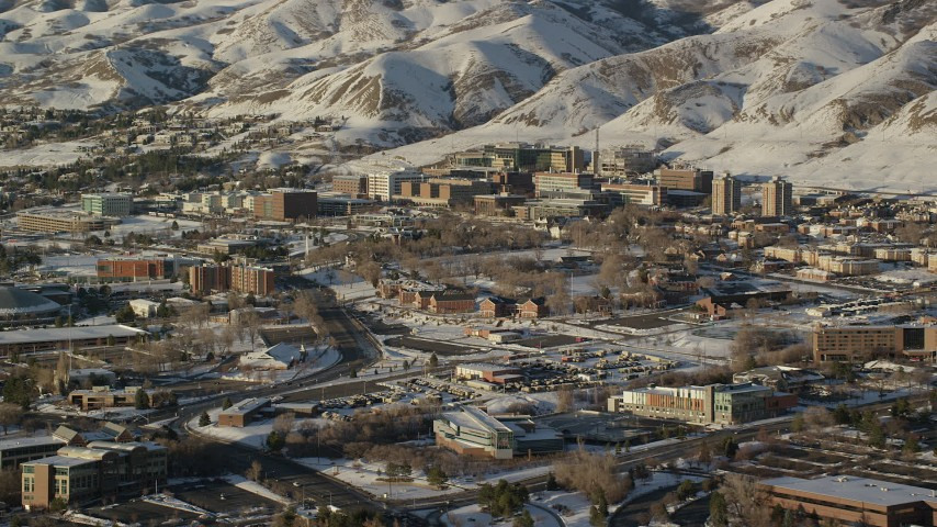 Orbit University of Utah Hospital with Winter Snow at Sunset Aerial Stock Footage AX127_081
