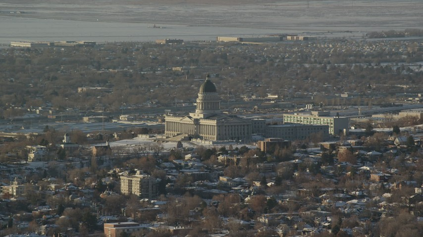 6K stock footage aerial video of Utah State Capitol with snow on the ground at sunset, Salt Lake City Aerial Stock Footage | AX127_083