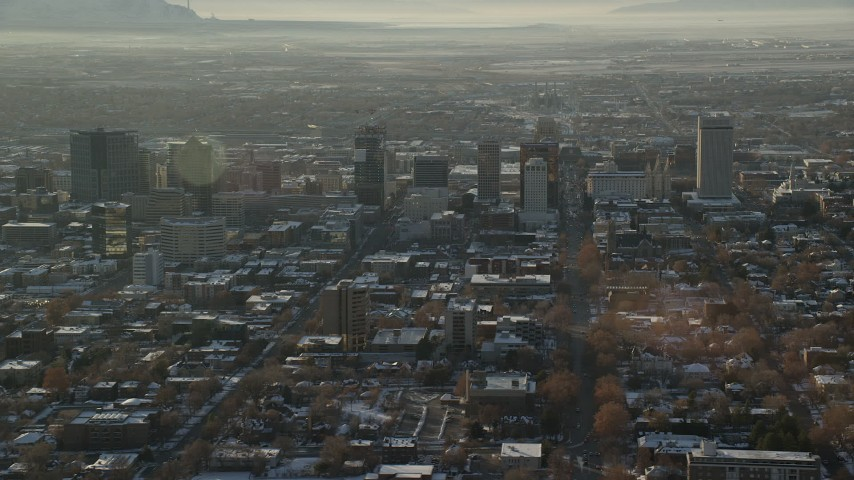 Orbit City Streets and Tall Buildings in Downtown Salt Lake City at Sunset in Wintertime Aerial Stock Footage | AX127_086