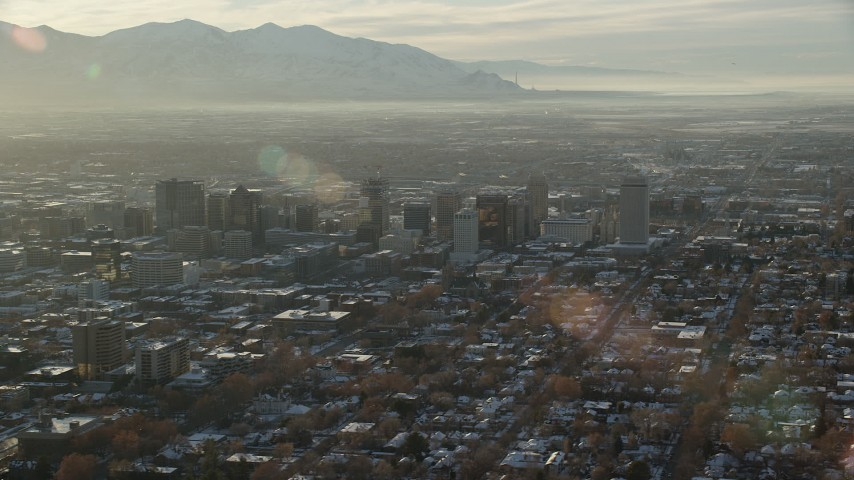 6K stock footage aerial video orbiting Downtown Salt Lake City with winter snow at sunset, Utah Aerial Stock Footage | AX127_087