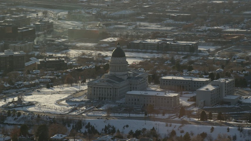 6K stock footage aerial video of circling Utah State Capitol with winter snow on the grounds at sunset, Salt Lake City Aerial Stock Footage | AX127_088