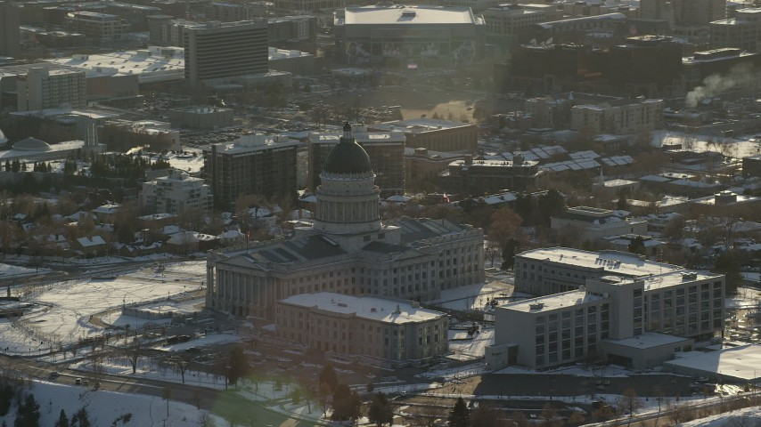 6K stock footage aerial video orbit the back of the Utah State Capitol with winter snow at sunset, Salt Lake City Aerial Stock Footage | AX127_089