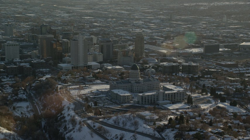 Orbit Utah State Capitol and Downtown with Winter Snow at Sunset Aerial Stock Footage | AX127_090
