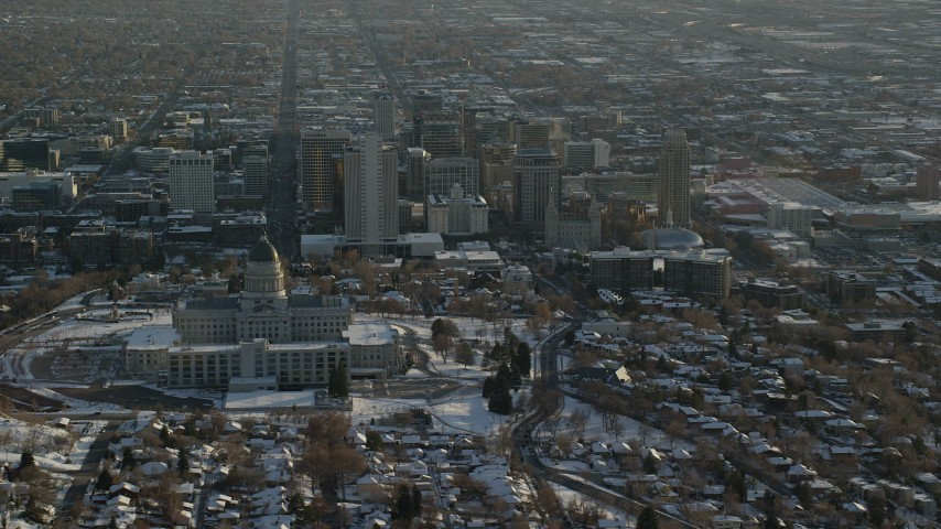 6K stock footage aerial video orbit of Utah State Capitol and Downtown Salt Lake City with winter snow at sunset Aerial Stock Footage | AX127_091