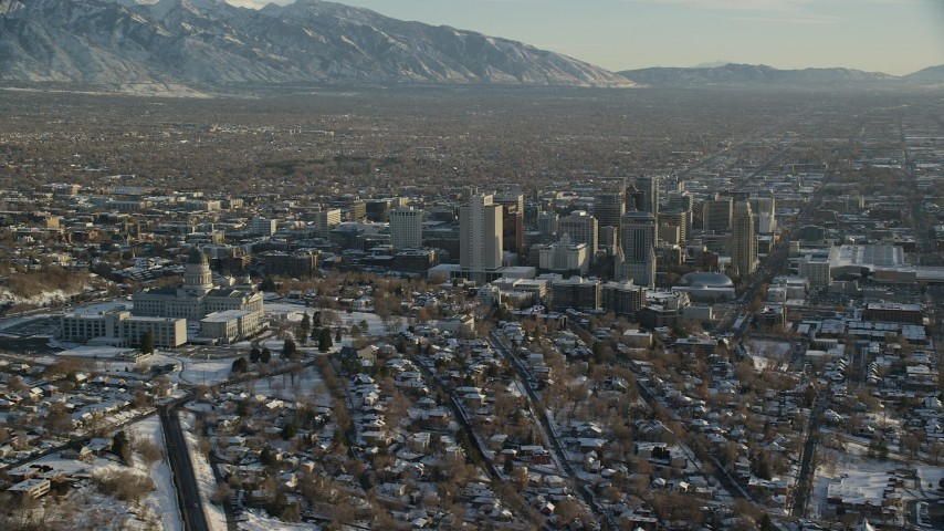 6K stock footage aerial video orbit the Utah State Capitol and Downtown Salt Lake City buildings with winter snow at sunset Aerial Stock Footage | AX127_092