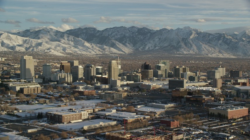 Orbit West Side of Downtown Salt Lake City with Winter Snow at Sunset Aerial Stock Footage | AX127_094