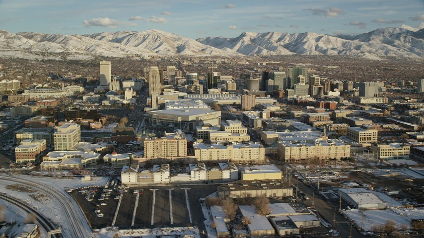 6K stock footage aerial video orbit Downtown Salt Lake City with winter snow at sunset, Utah Aerial Stock Footage | AX127_096