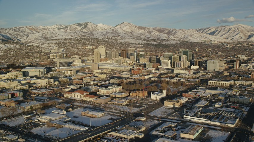 6K stock footage aerial video orbit of Downtown Salt Lake City with winter snow at sunset, Utah Aerial Stock Footage | AX127_098