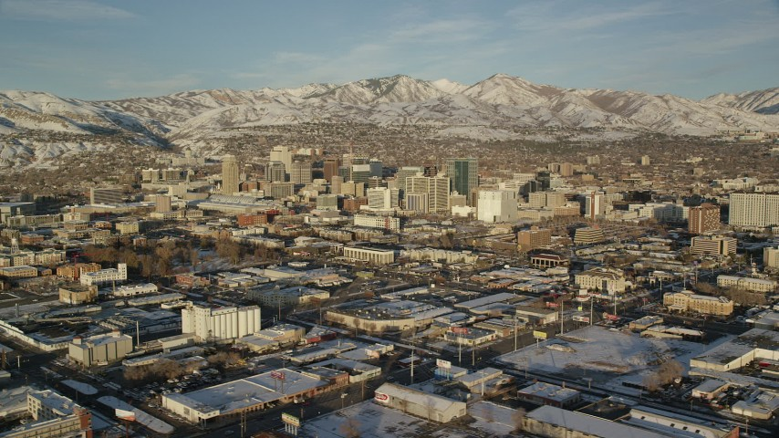 Orbit Downtown Salt Lake City with Snow at Sunset in Wintertime Aerial Stock Footage | AX127_099