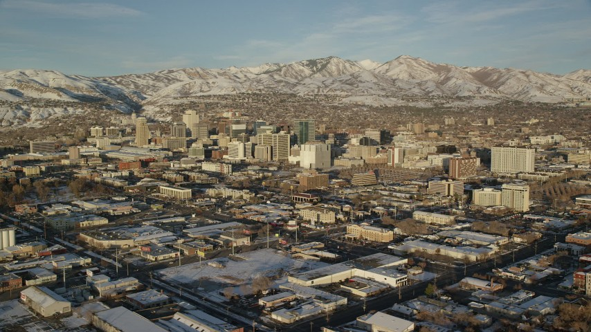 6K stock footage aerial video of circling Downtown Salt Lake City with winter snow at sunset, Utah Aerial Stock Footage | AX127_100