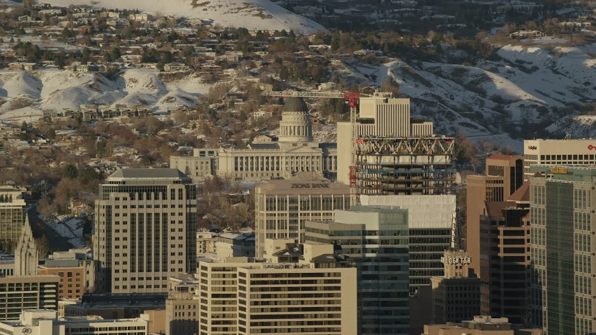 Orbit Downtown Buildings with Utah State Capitol and Winter Snow at Sunset Aerial Stock Footage | AX127_102