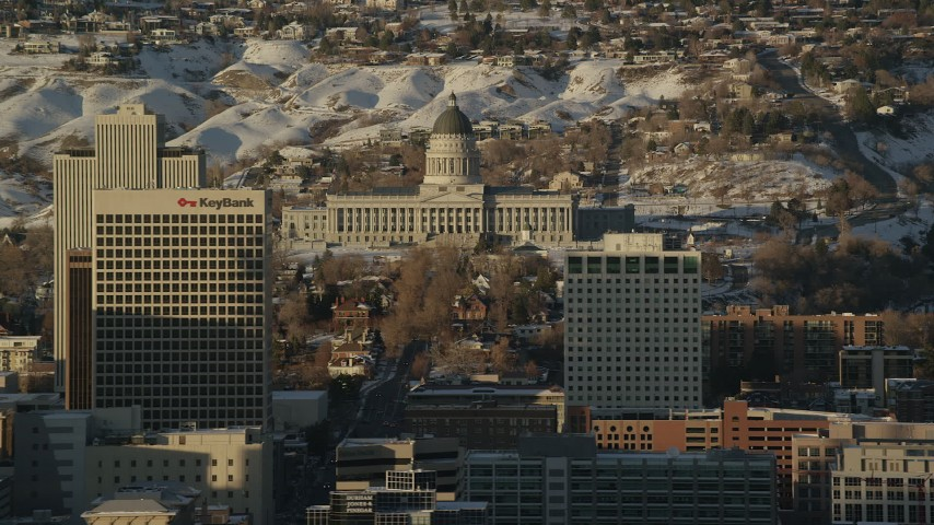Reveal Utah State Capitol with Winter Snow Behind Downtown Buildings at Sunset Aerial Stock Footage | AX127_103