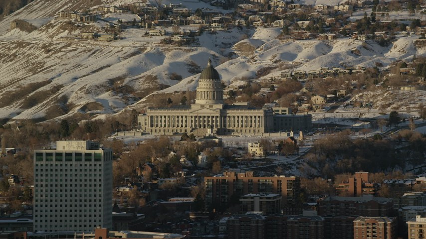 Orbit Utah State Capitol by Snowy Hills at Sunset in Wintertime Aerial Stock Footage | AX127_104