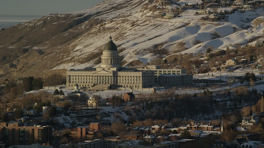 Orbit Front of the Utah State Capitol with Winter Snow at Sunset Aerial Stock Footage | AX127_105