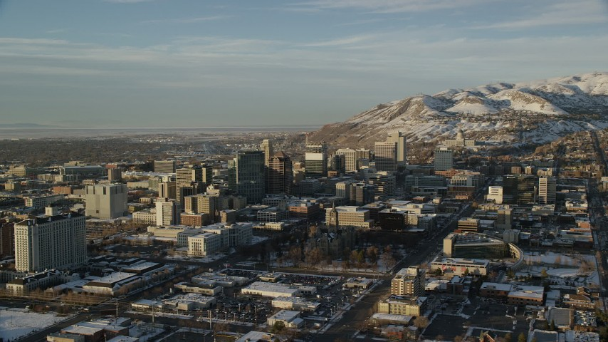 Orbit Downtown Salt Lake City and the State Capitol Building with Winter Snow at Sunset Aerial Stock Footage | AX127_108