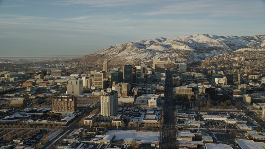 6K stock footage aerial video of orbiting Downtown Salt Lake City at sunset with winter snow, Utah Aerial Stock Footage | AX127_109
